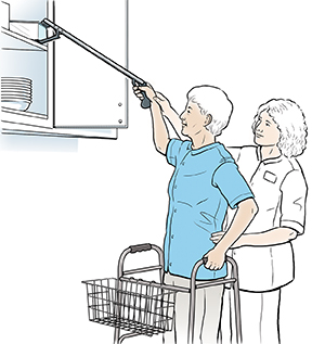 Healthcare provider showing woman how to use long-handled reacher.