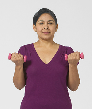Woman working out with hand weights.