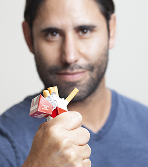 Man crushing cigarettes.