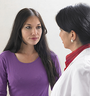 Healthcare provider talking to woman.
