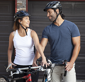 Man and woman on bicycles.