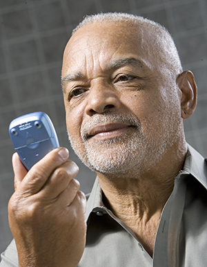 Man looking at glucose meter.