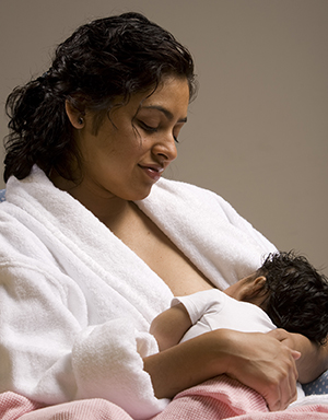 Woman breastfeeding baby.