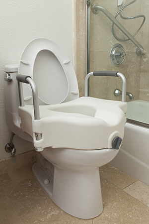 Elevated commode seat on toilet.